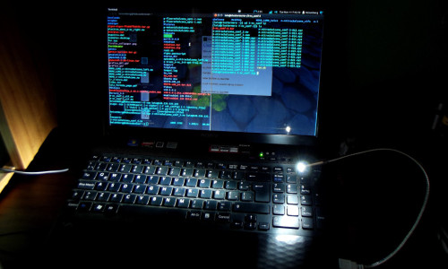 Laptop in the dark by Luis Romero