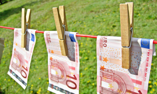 Money Laundering - Euros by Images Money